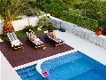 Pool with sun lounges