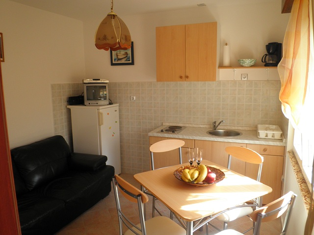 Kitchen With Dining Table And Sofa