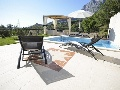 Pool with sun lounges at villa Majda